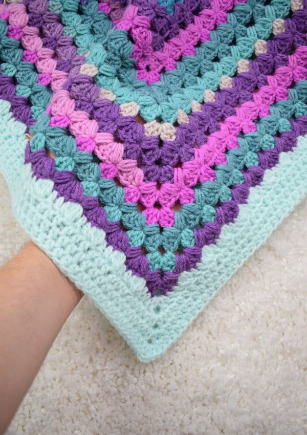 """Crochet """"Rosemary"""" blanket- made with granny stitch and decorated with puff stitches"""